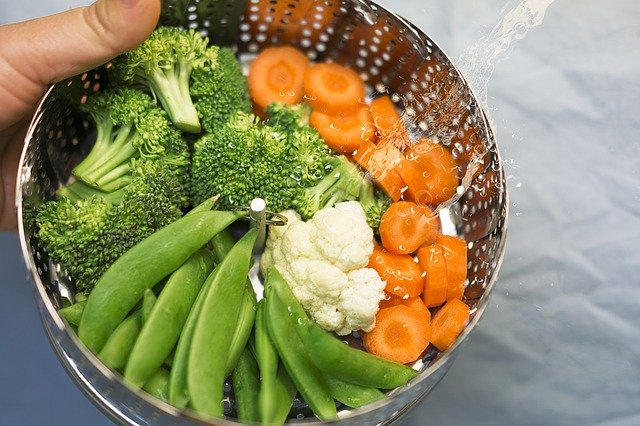 A bowl of food with broccoli