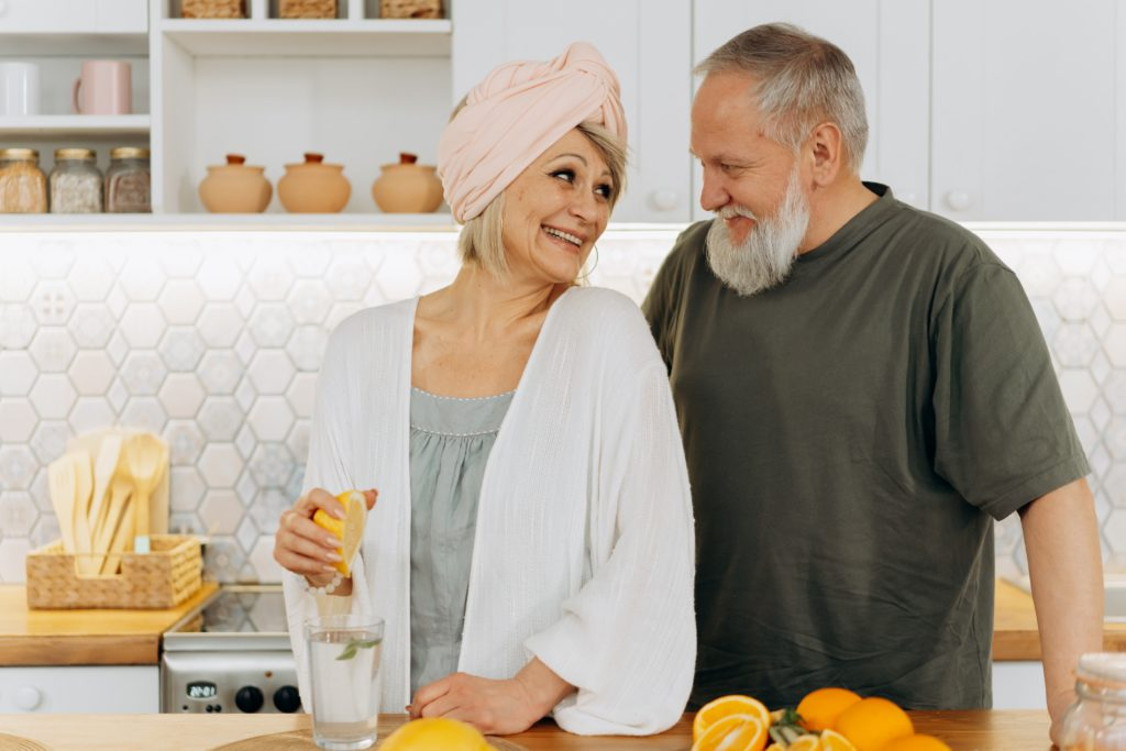 A man and a woman sitting on a counter